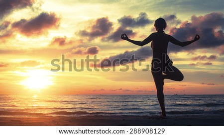 Silhouette of a woman yoga on sea sunset. Healthy lifestyle and fitness concept.  - stock photo