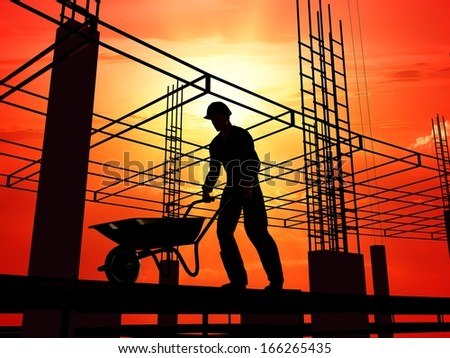 Silhouette of a worker with a wheelbarrow at a construction site.