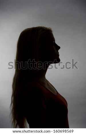 Silhouette of a young blond woman - stock photo