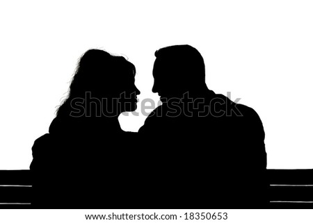 Silhouette of a young couple in love - stock photo