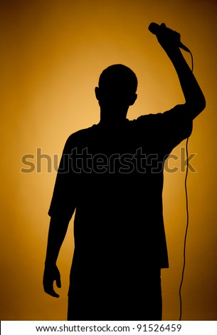 Silhouette of a young man in orange, darkened at the edges.
