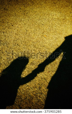 Silhouette of adult and toddler girl - stock photo
