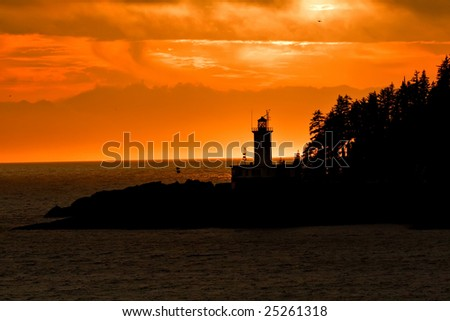 Silhouette of Alaskan Lighthouse during Sunset