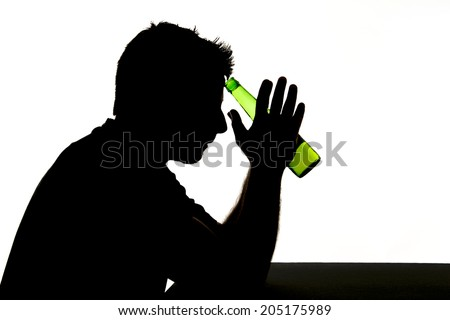 silhouette of alcoholic drunk young man drinking beer bottle feeling depressed falling into addiction problem isolated on white background - stock photo