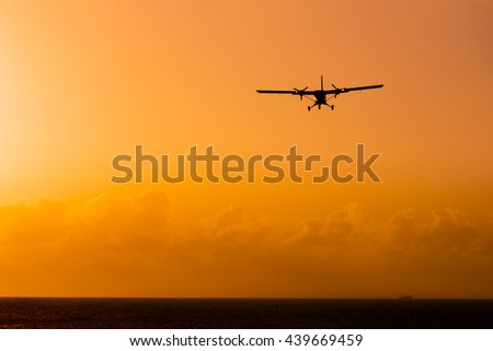 Silhouette of an airplane at sunset.