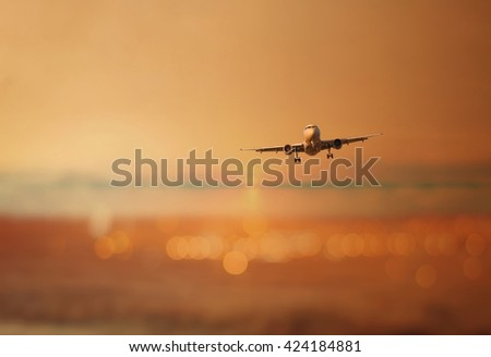 Silhouette of an airplane in flight on a bokeh evening sky