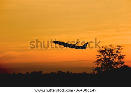 Silhouette of an airplane taking off, Sunrise in the morning sky.