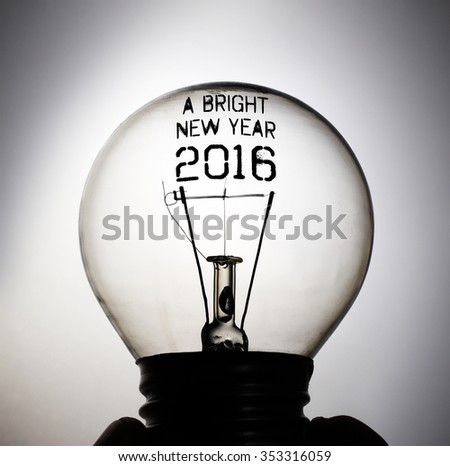 Silhouette of an incandescent light bulb with the message: A Bright New Year 2016. - stock photo