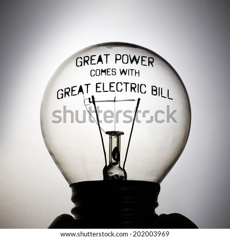 Silhouette of an incandescent light bulb with the message: Great Power comes with Great Electric Bill. - stock photo
