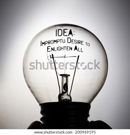 Silhouette of an incandescent light bulb with the message: IDEA Impromptu Desire to Enlighten All. - stock photo