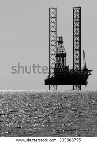Silhouette of an offshore drilling rig, South China Sea, Malaysia  - stock photo