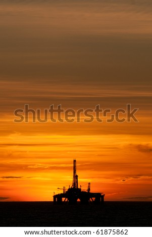 silhouette of an oil drilling rig.  Coast of Brazil - stock photo