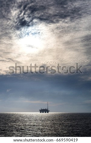 silhouette of an oil drilling rig in the North Sea