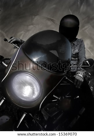 Silhouette of an old style moto rider against grunge background. - stock photo