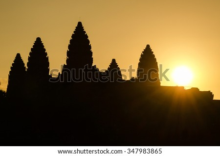 Silhouette of Angkor Wat at sunrise in Cambodia - stock photo