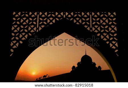silhouette of arabic architecture  on desert - stock photo