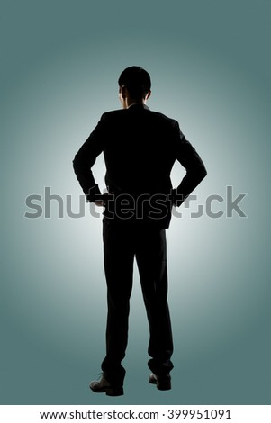 Silhouette of Asian business man standing, full length portrait isolated - stock photo
