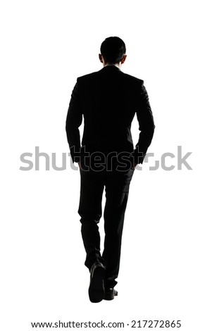 Silhouette of Asian business man walk with confidence, full length portrait isolated on white. Rear view. - stock photo
