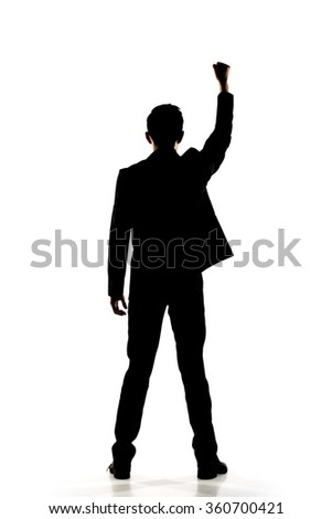 Silhouette of Asian businessman open arms feel free, rear view, full length portrait isolated - stock photo