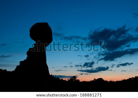 Silhouette of Balanced Rock in Arches National Park, Utah. - stock photo