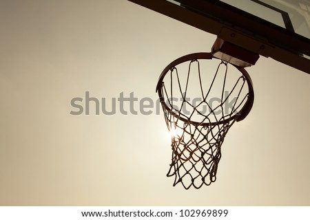 silhouette of Basketball Basket in the sunset - stock photo