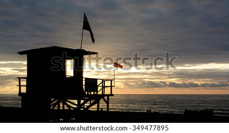 silhouette of beach lifeguards towers - stock photo