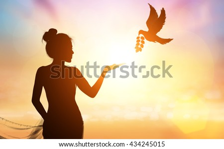 silhouette of bird carrying leaf branch for two hand - stock photo