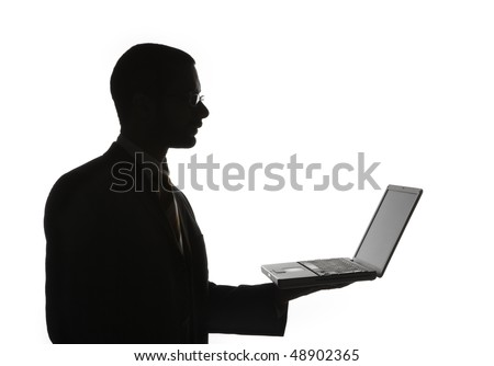 Silhouette of Black businessman in profile with laptop computer, isolated on white background, - stock photo