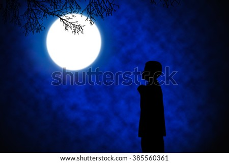 Silhouette of boy praying over beautiful full moon at night . - stock photo