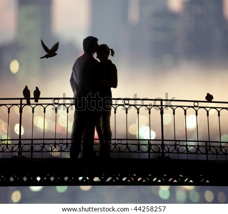 silhouette of bridge and pair of lovers on city background - stock photo