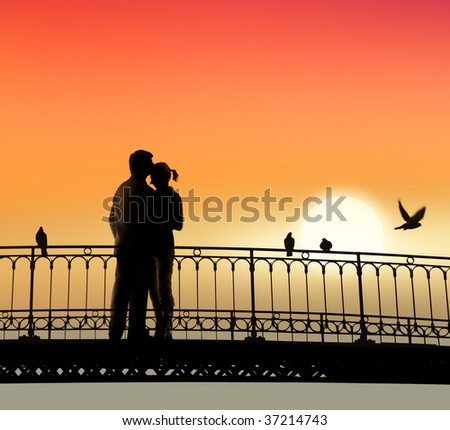 silhouette of bridge and pair of lovers on sunset background - stock photo