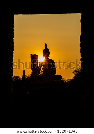 Silhouette of buddha and pagoda after sunset, wat Phra sri sanphet temple, Ayutthaya, Thailand - stock photo