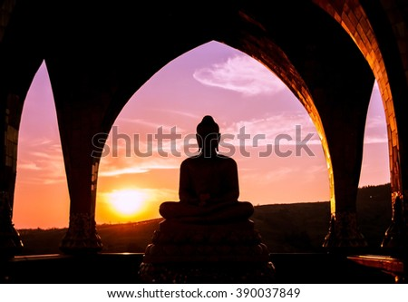Silhouette of buddha at Wat Pha Sorn Kaew or Wat Phra Thart Pha Kaew, the public buddhist monastery and temple in Khao Kor in the dark evening during sunset with backlight, Thailand - stock photo