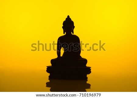 Silhouette of Buddha on Golden Background