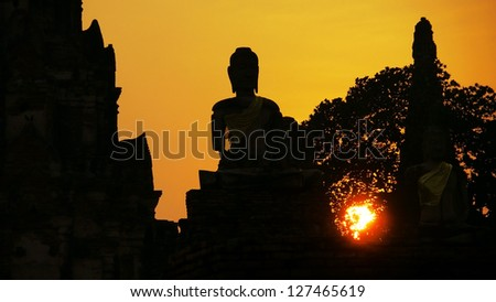Silhouette of Buddha Statue at Wat Chaiwattanaram, Ayutthaya, Thailand. - stock photo