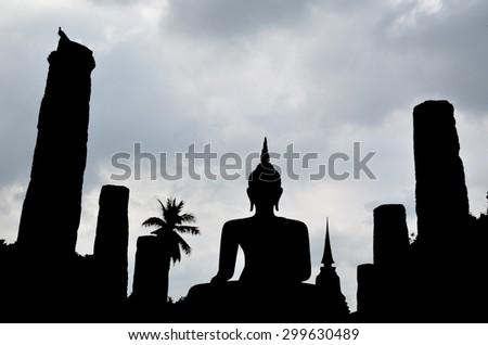 Silhouette of buddha statue,Thailand / Silhouette of buddha statue in Sukhothai historical park, Sukhothai, Thailand - stock photo
