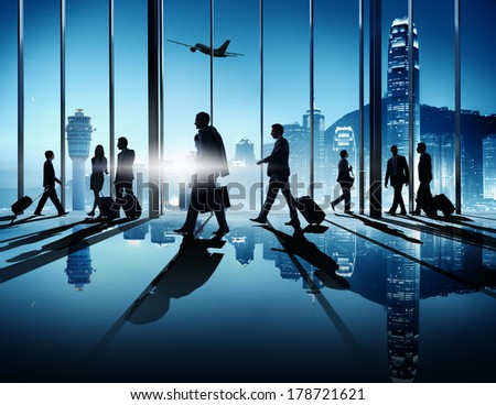 Silhouette of Business People at Airport - stock photo