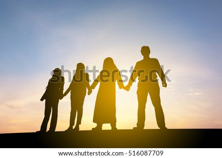 Silhouette of Business People Celebration Success Happiness Team at Sunset Evening Sky Background