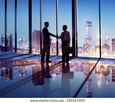 Silhouette of Business People Hand Shaking in the Office - stock photo