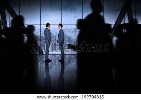 Silhouette of business people walking against room with large window looking on city - stock photo