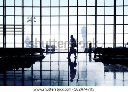 Silhouette Of Businessman At Airport Terminal
