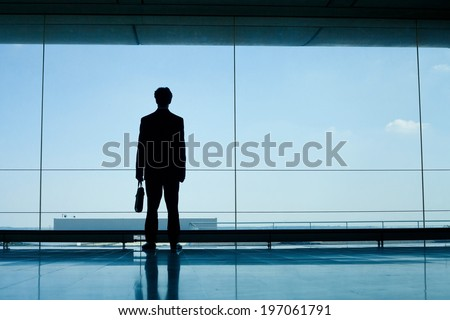 silhouette of businessman in office interior - stock photo