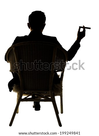 Silhouette of businessman sit on chair and hold a cigar, full length portrait isolated on white background. - stock photo