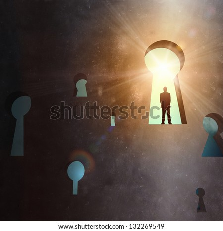 Silhouette of businessman standing in keyhole sun shining above - stock photo