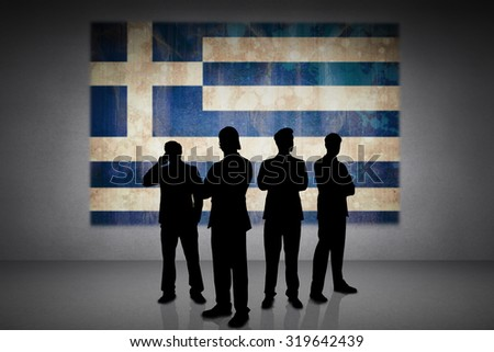 Silhouette of businessmen against greece flag in grunge effect