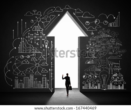 Silhouette of businesswoman against black wall with key hole - stock photo