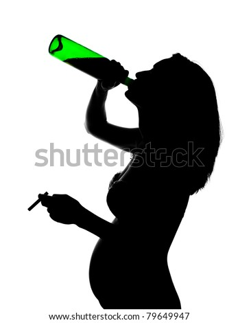 Silhouette of careless pregnant woman with alcohol and cigarette - stock photo