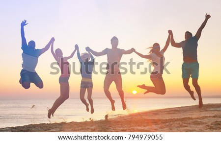 Silhouette of cheering young generation jumping on outdoor beautiful Rear view background. relax lifestyle hope faith love grow kid hands Happiness fitness exercising volleyball future party relation