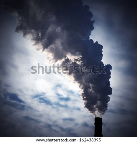 silhouette of chimney-stalk with smoke