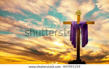 Silhouette of Christian cross at sunrise or sunset panoramic view - stock photo